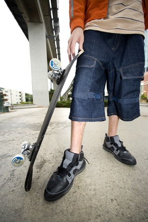 teenaged boy: A teenager with a skateboard
