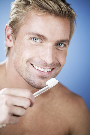 A young man brushing his teeth Stock Photo