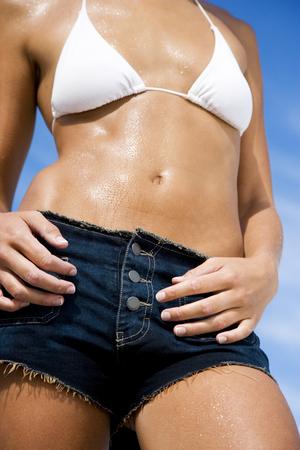 bikini top: A young woman bikini top and shorts