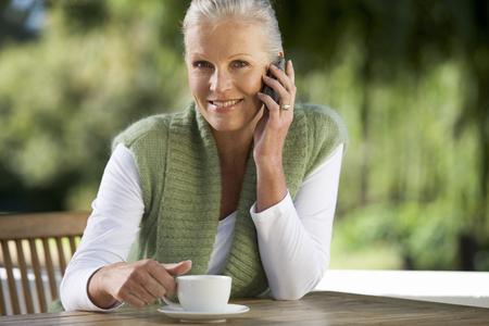 A senior woman talking on a mobile phone Stock fotó