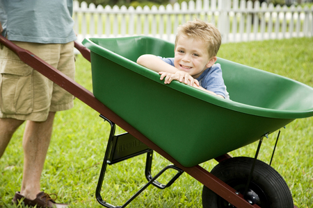 boy having a ride in a wheelbarrow