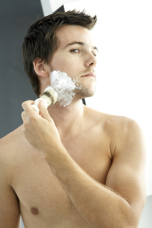 grooming product: Young man shaving