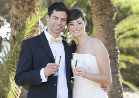 A bride and groom drinking champagne Stock Photo