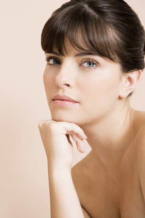 Young woman looking pensive, thinking Stock Photo