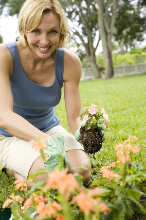 woman planting new plant