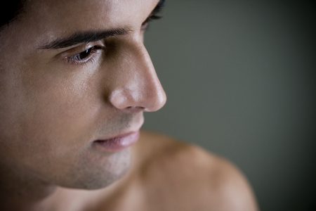 Portrait of a young man looking pensive Stock Photo