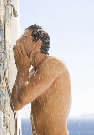 A man cooling off under a shower