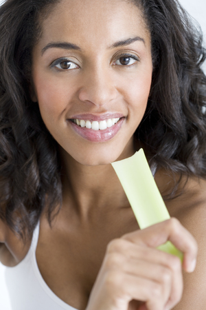 A woman holding a stick of celery Stock Photo