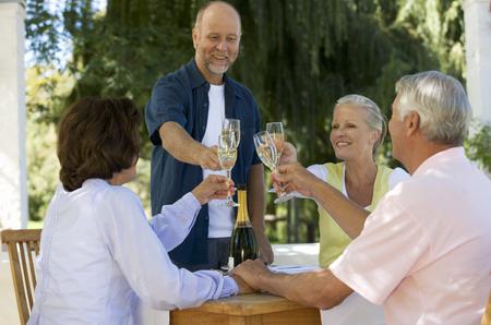 A group of senior couples celebrating