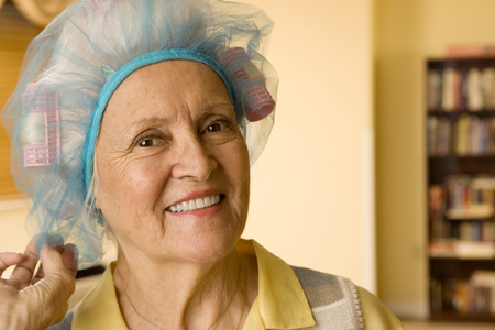 An elderly woman wearing curlers Stock fotó - 96414596