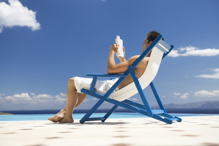 A man relaxing in a deck chair LANG_EVOIMAGES