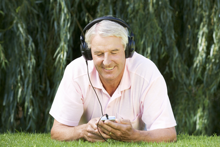 A senior man listening to music Stock fotó