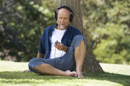 A senior man listening to music Stock fotó - 96414724