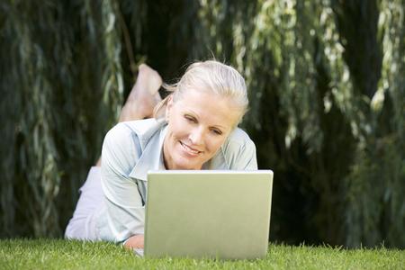 A senior woman using a laptop