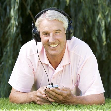 A senior man listening to music Stock fotó - 96414760