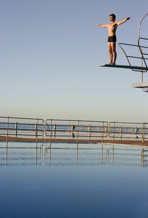 waiting posture: A diver standing on a diving board