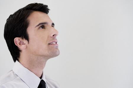 positivist: Side profile portrait of a businessman looking happy LANG_EVOIMAGES