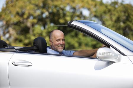A senior man driving a car Stock fotó
