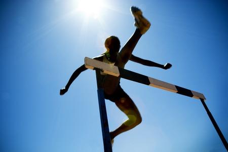 Female hurdler in action Reklamní fotografie