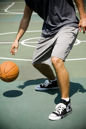 outdoor basketball court: Man on an outdoor basketball court, close up