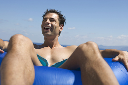 A man relaxing in a pool LANG_EVOIMAGES