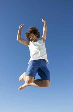 A young man jumping