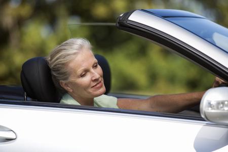 A senior woman driving a car Stock fotó