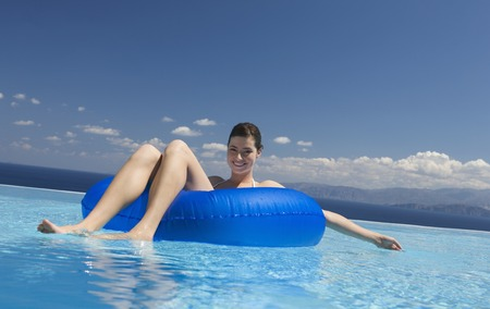 lilo: A woman relaxing in a pool