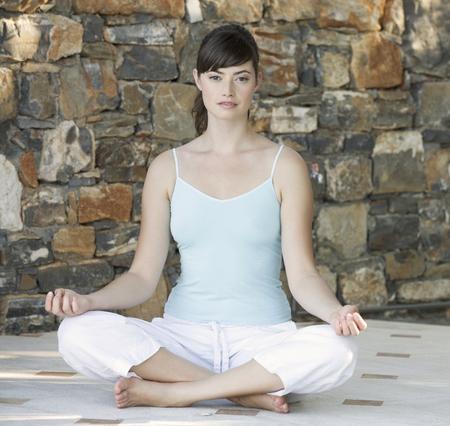 woman meditating: A woman meditating LANG_EVOIMAGES