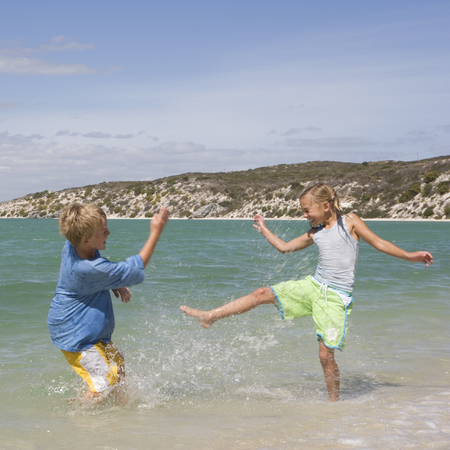 splashed: Two children playing in the sea