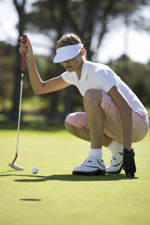 woman golf: Woman playing golf