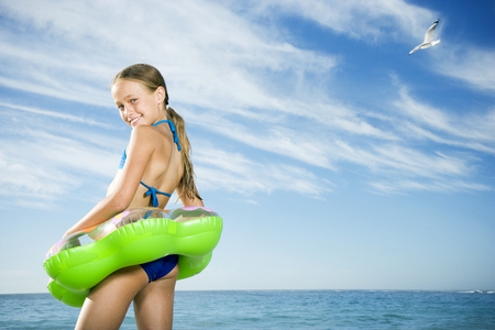 rubber ring: A young girl on the beach with rubber ring LANG_EVOIMAGES