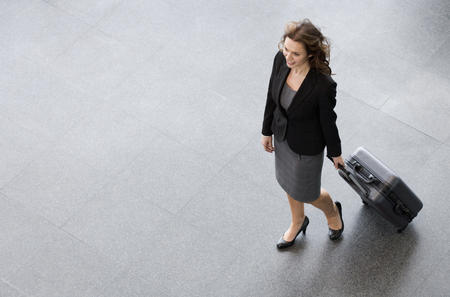 A businesswoman and suitcase