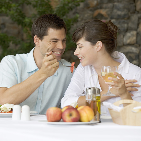 A couple sharing a romantic meal