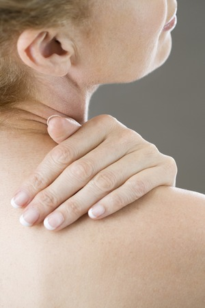 back rub: A woman with her hand on her shoulder