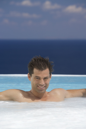 jacuzzi: A man relaxing in a jacuzzi LANG_EVOIMAGES