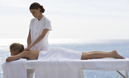 massaged: A young woman having a massage