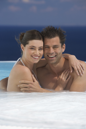 jacuzzi: A couple relaxing in a jacuzzi