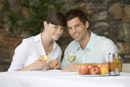A couple sharing a bottle of wine at a table Stock Photo