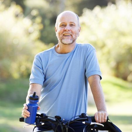 A senior man cycling Stock fotó