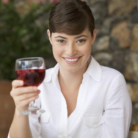 A woman enjoying a glass of wine