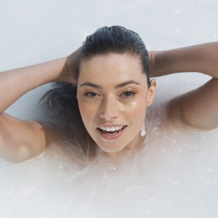 jacuzzi: A woman relaxing in a jacuzzi
