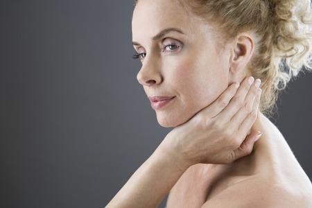 neuralgia: A woman touching her neck