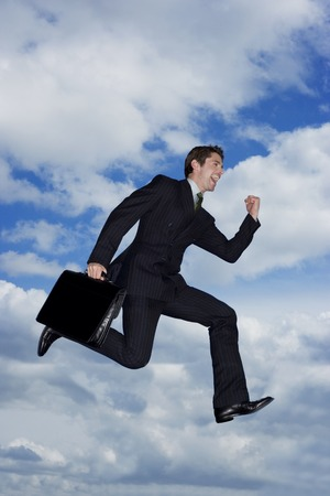 caida libre: A businessman holding a briefcase, leaping in the air