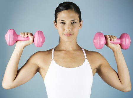 A young woman lifting weights