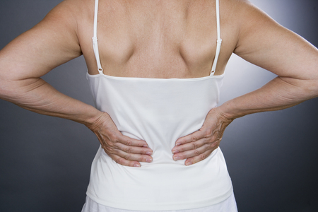 middle joint: A senior woman with backache
