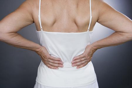 back rub: A senior woman with backache