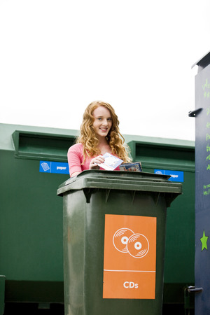 cds: A teenage girl recycling cds