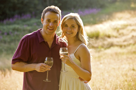 above 30: Portrait of a young couple drinking wine