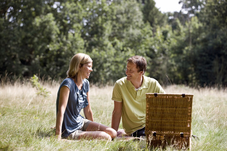 A middle aged couple having a picnic